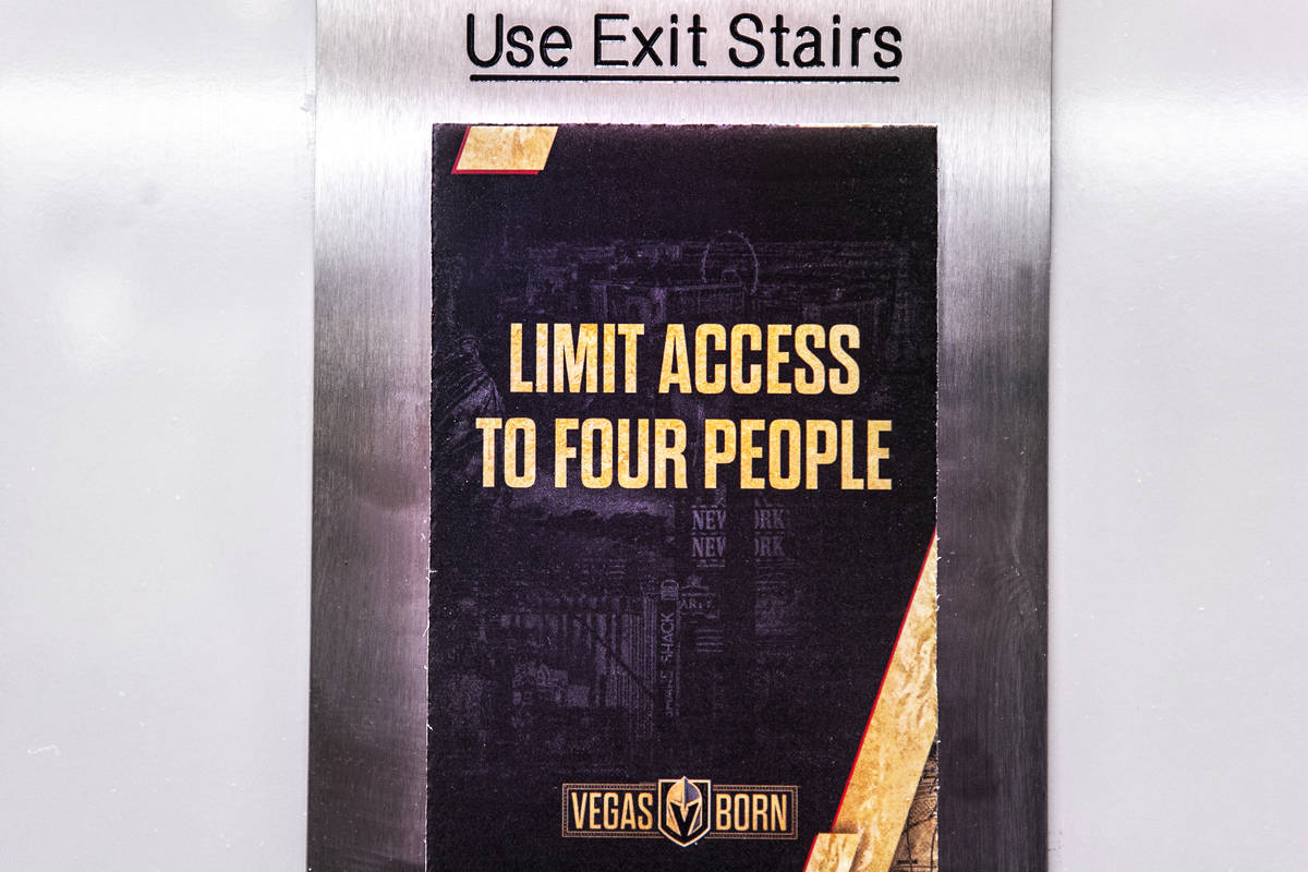 Signs restricting elevator capacity due to COVID-19 at T-Mobile Arena on Thursday, Feb. 25, 202 ...