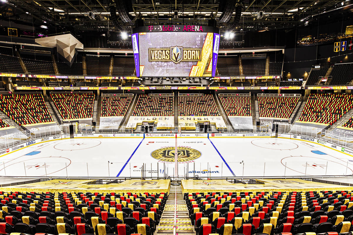 Red and gold wrapped seats provide social distance between fans at T-Mobile Arena on Thursday, ...