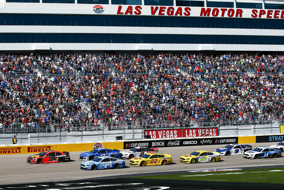 Cars round the track during a NASCAR Cup Series auto race at Las Vegas Motor Speedway on Sunday ...