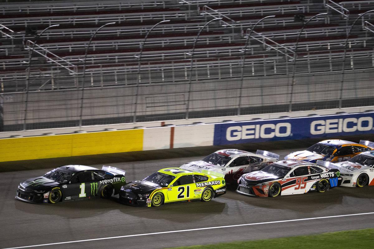 Drivers trail behind race winner Kurt Busch (1) duringa NASCAR Cup Series auto race ...