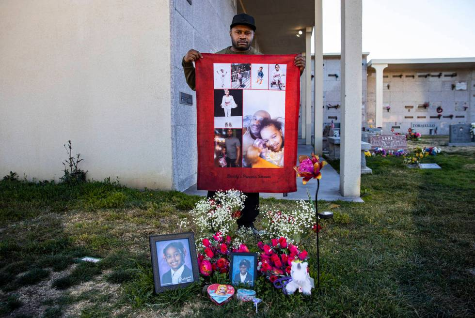 Brian Bradford poses for a portrait by the grave of his daughter, Briana Bradford, on the two-y ...