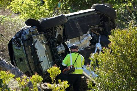 A vehicle rests on its side after a rollover accident involving golfer Tiger Woods Tuesday, Feb ...