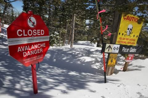 A sign alerts skiers to danger on Corona Bowl, known for its extreme skiing, at Eldora Mountain ...