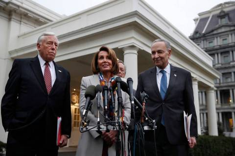 House Democratic leader Nancy Pelosi of California, center, speaks to the media after meeting w ...