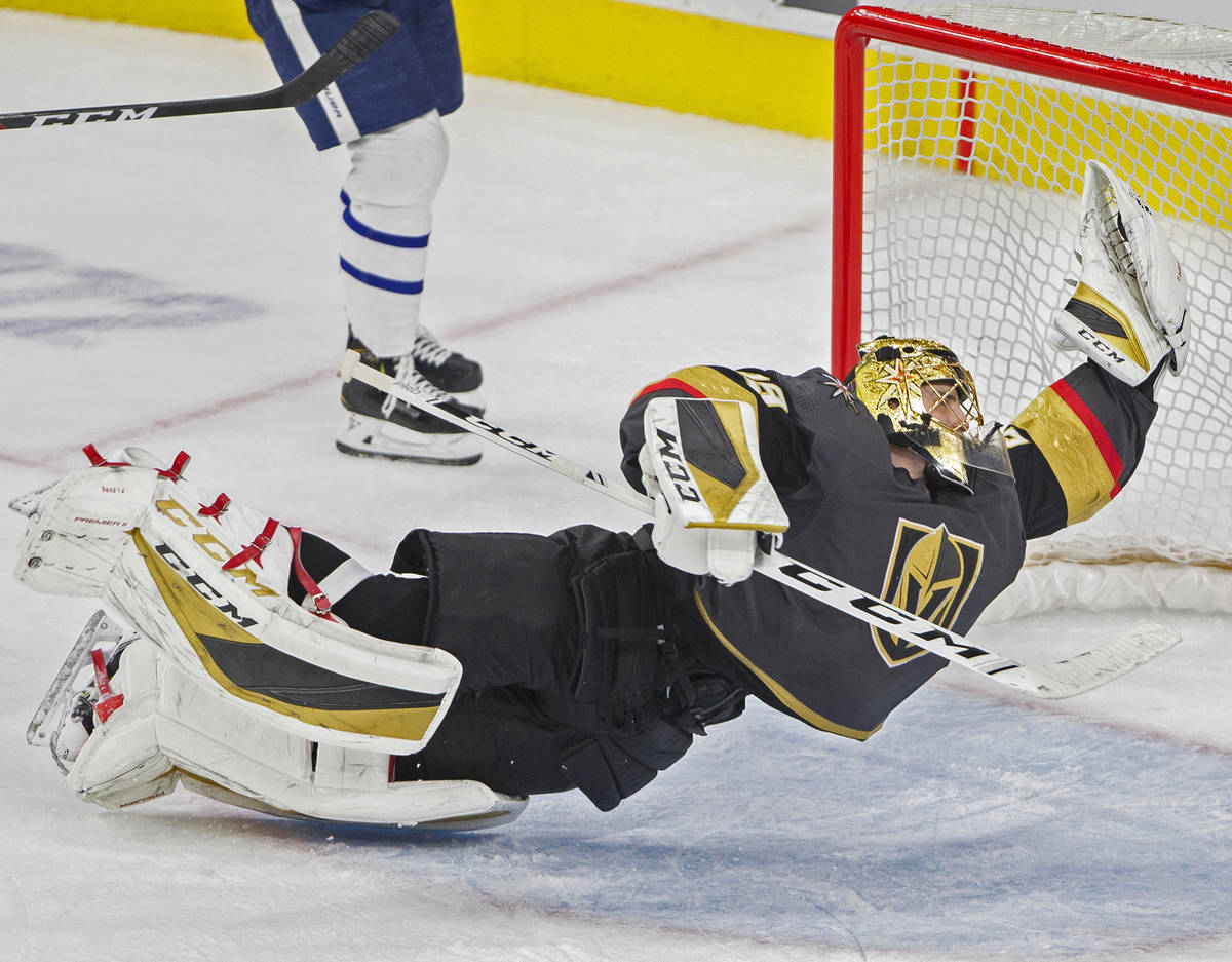 Vegas Golden Knights goaltender Marc-Andre Fleury (29) makes a diving save in the third period ...