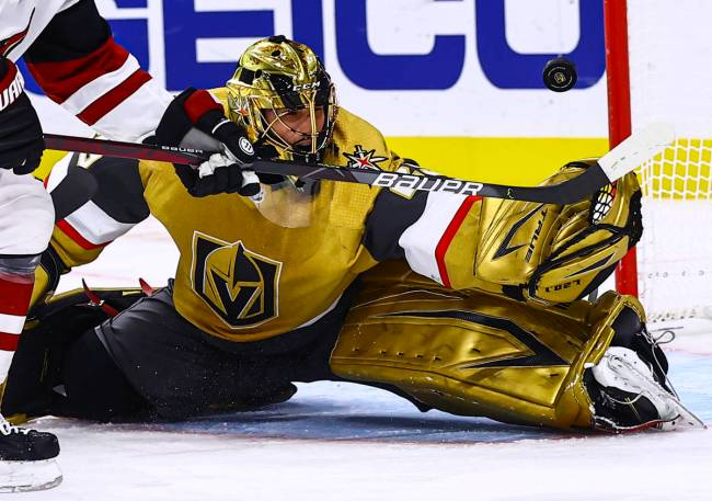 Golden Knights goaltender Marc-Andre Fleury (29) blocks the puck in front of Arizona Coyotes le ...