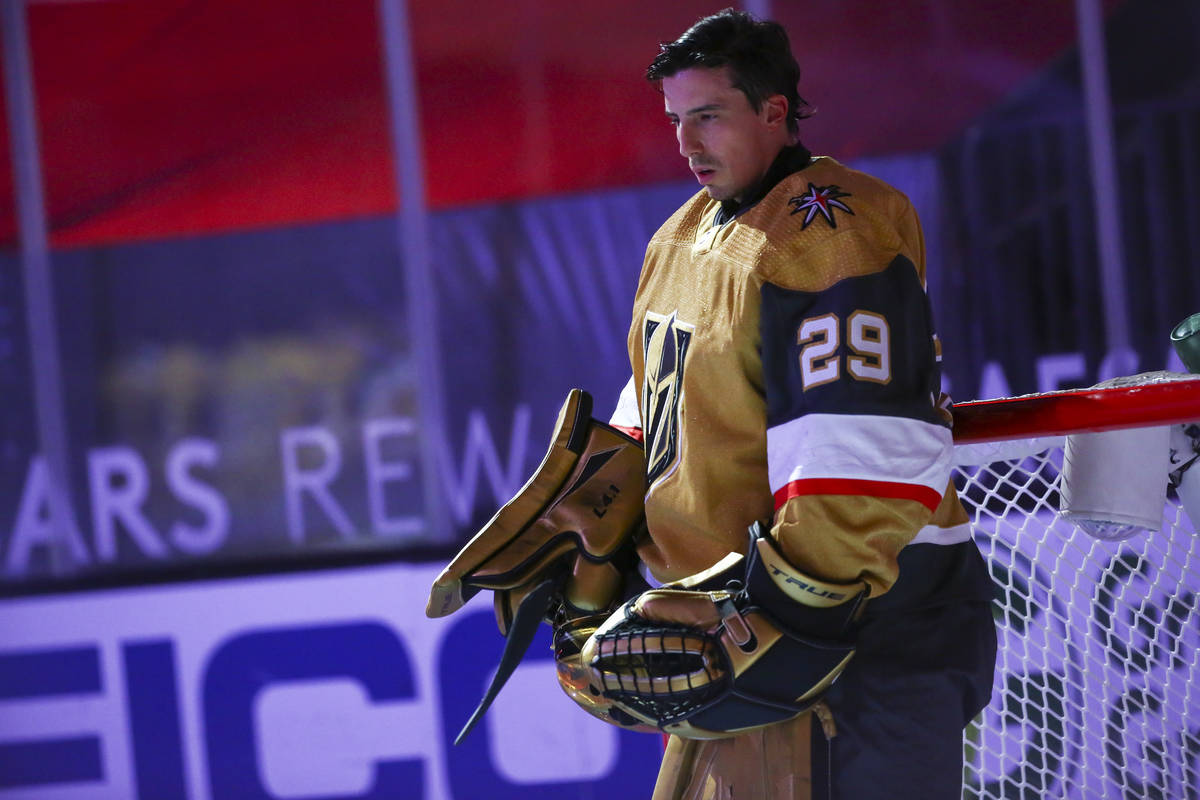 Golden Knights goaltender Marc-Andre Fleury (29) stands for the national anthem before an NHL h ...
