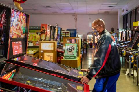 Oliver Blair, 46, of San Antonio, Texas, plays games at the Pinball Hall of Fame in 2020 in Las ...