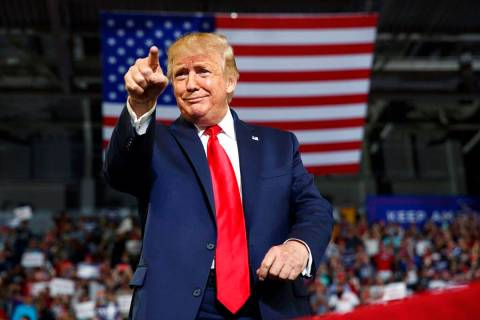 President Donald Trump gestures to the crowd as he arrives to speak at a campaign rally at Will ...