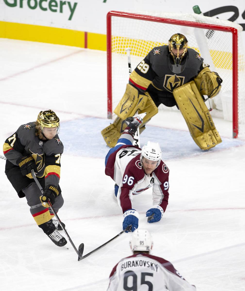 Golden Knights center William Karlsson (71) reaches while Colorado Avalanche right wing Mikko R ...