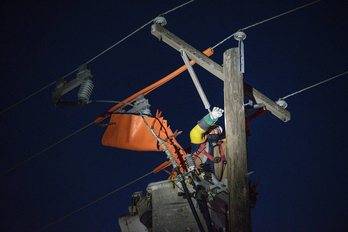 Oncor apprentice lineman Brendan Waldon repairs a utility pole that was damaged by the winter s ...