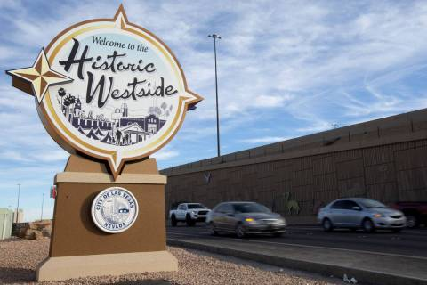 "Traffic moves past the newly placed ""Welcome to the Historic Westside"" sign off of US95 and Mar ..."