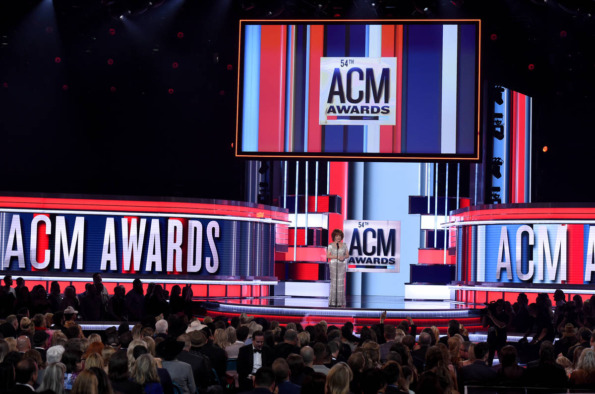 This April 7, 2019 file photo shows host Reba McEntire on stage at the 54th annual Academy of C ...