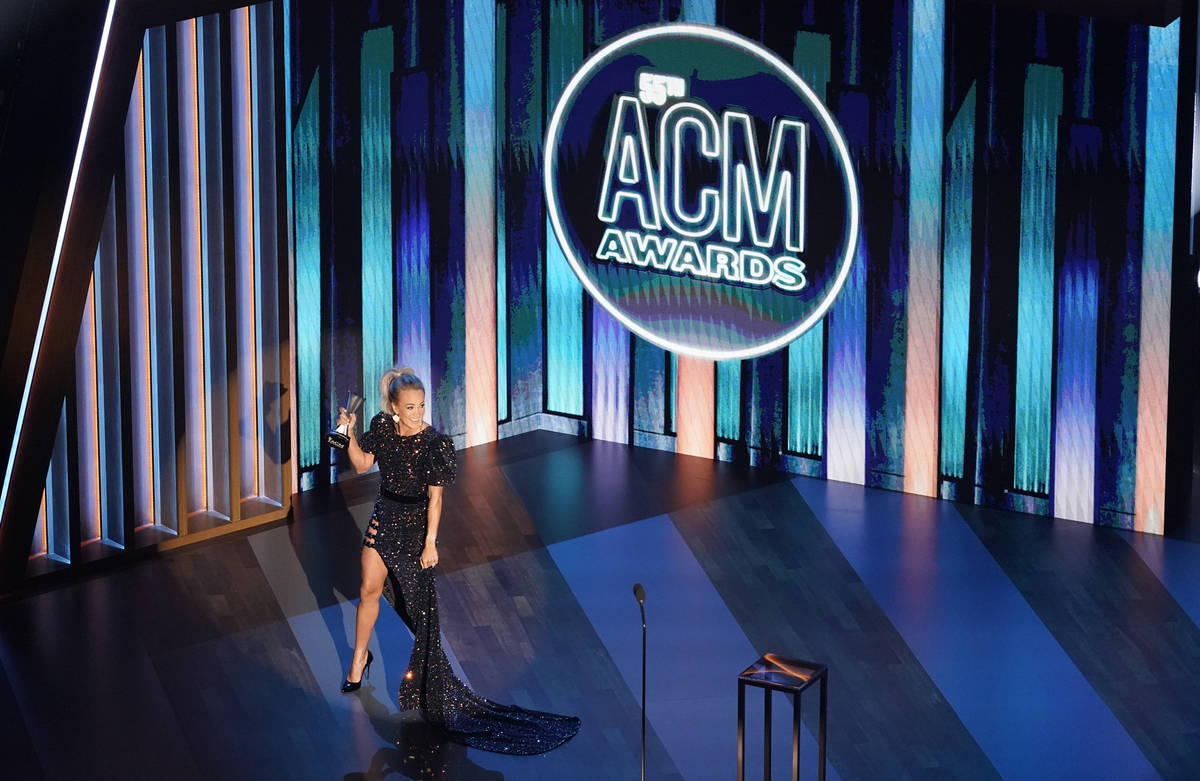 Carrie Underwood accepts the entertainer of the year award in a tie with Thomas Rhett during th ...