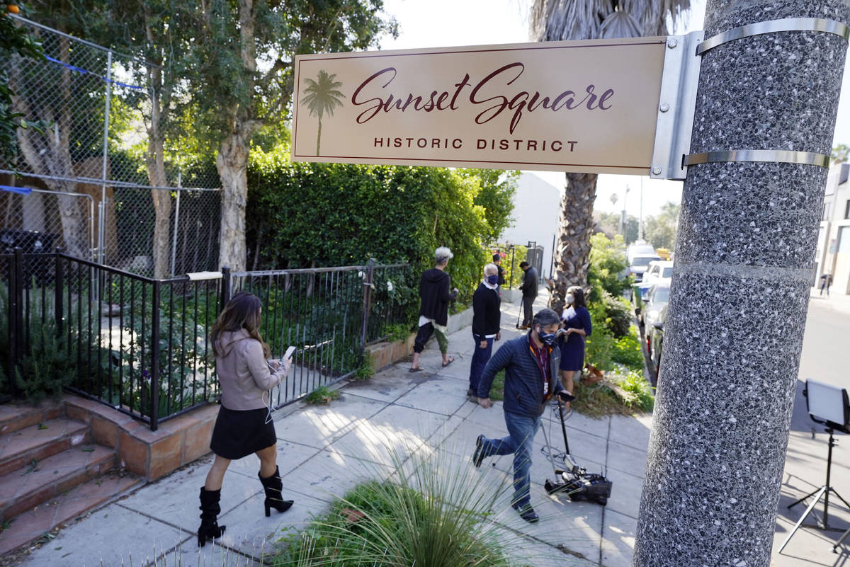 Members of the media and neighbors walk near an area on North Sierra Bonita Ave. where Lady Gag ...