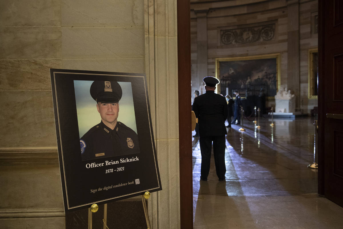 FILE - In this Feb. 2, 2021, file photo a placard is displayed with an image of the late U.S. C ...
