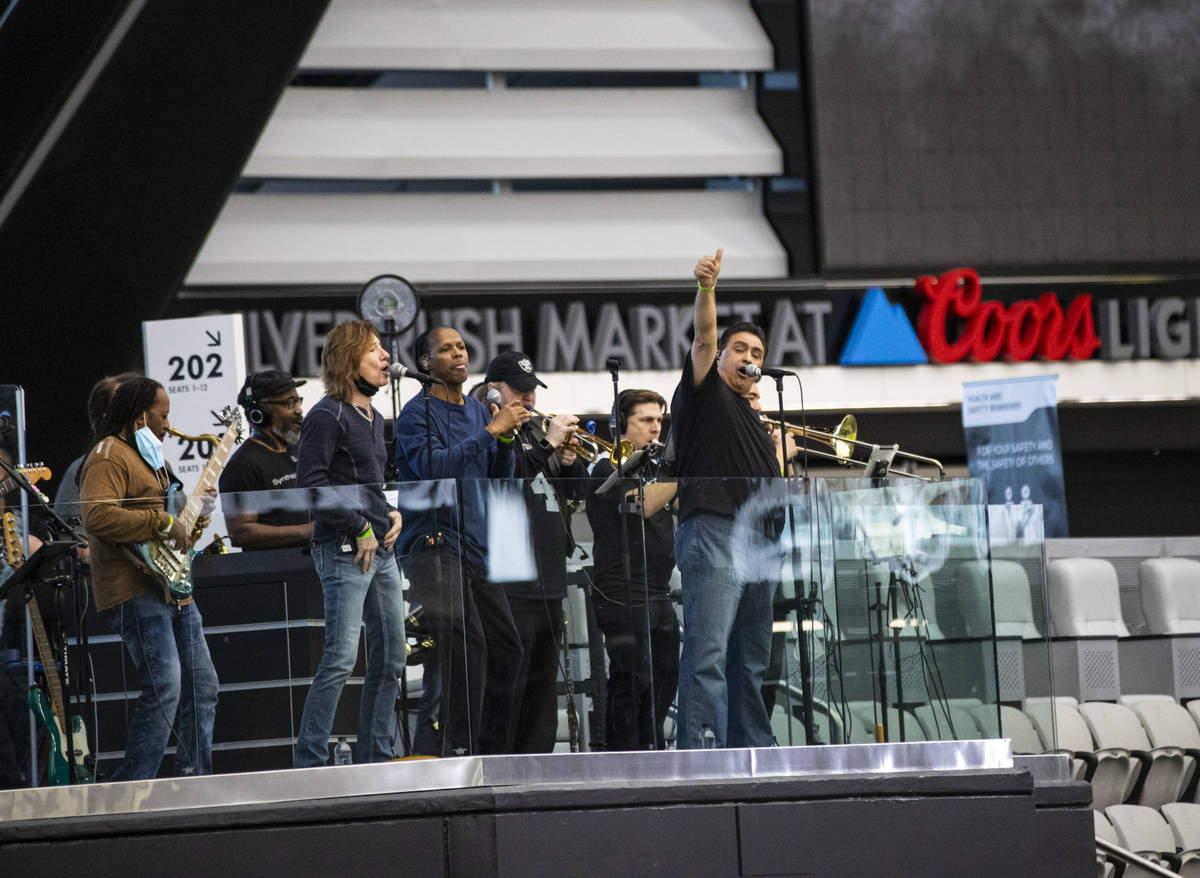 Members of Santa Fe & The Fat City Horns perform during soundcheck at Allegiant Stadium in ...