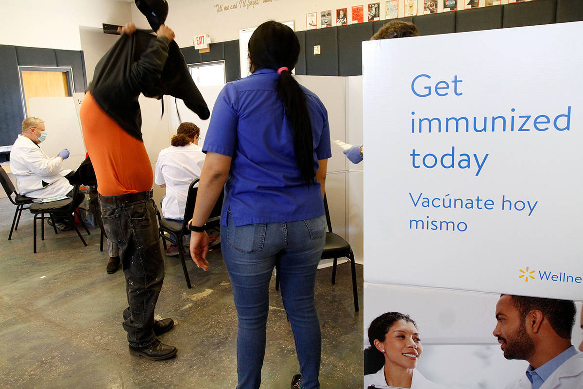 The Immigrant Home Foundation and Walmart conduct a first-dose vaccine clinic in east Las Vegas ...