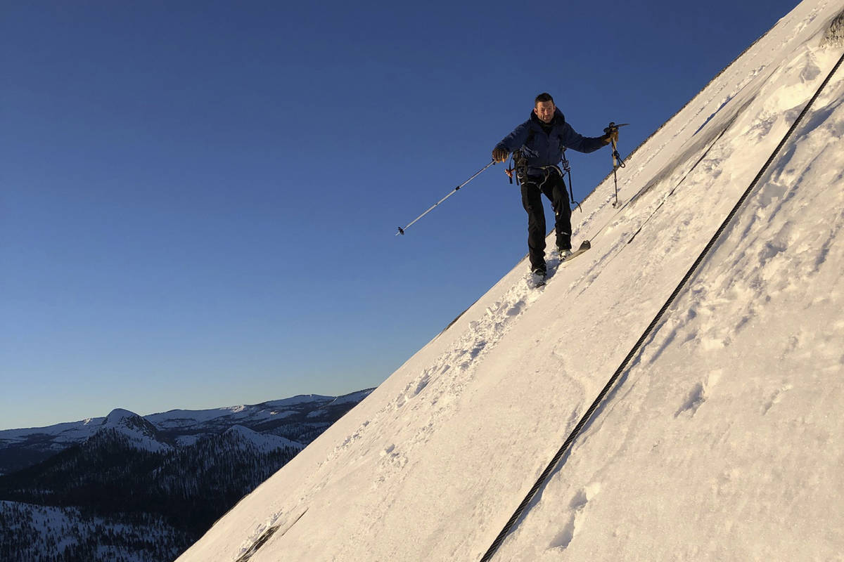 In this photo provided by Jason Torlano, Zach Milligan is shown on his descent down Half Dome i ...