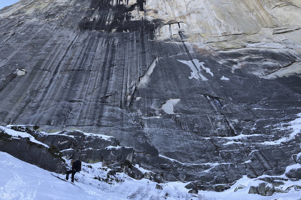 In this photo provided by Jason Torlano, Zach Milligan, lower left, makes his descent down Half ...