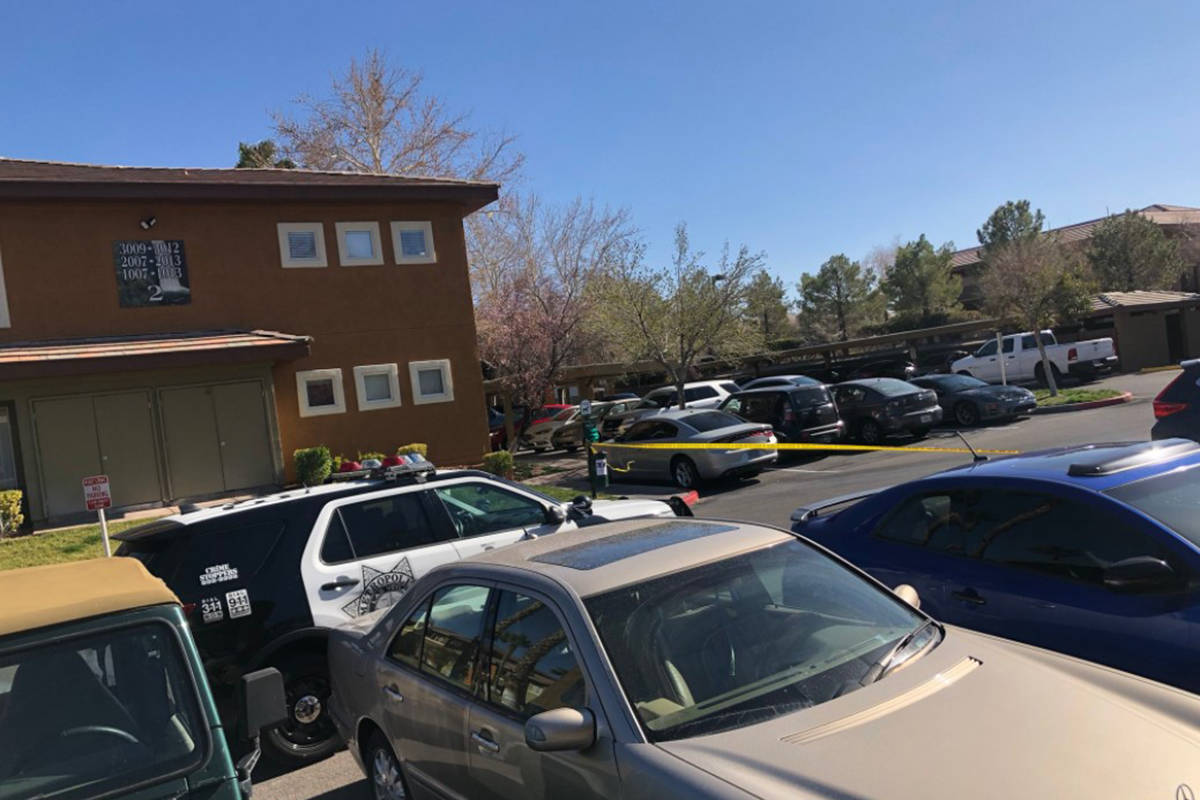Police conduct a homicide investigation Saturday, Feb. 27, 2021, on the 1300 block of North Tow ...