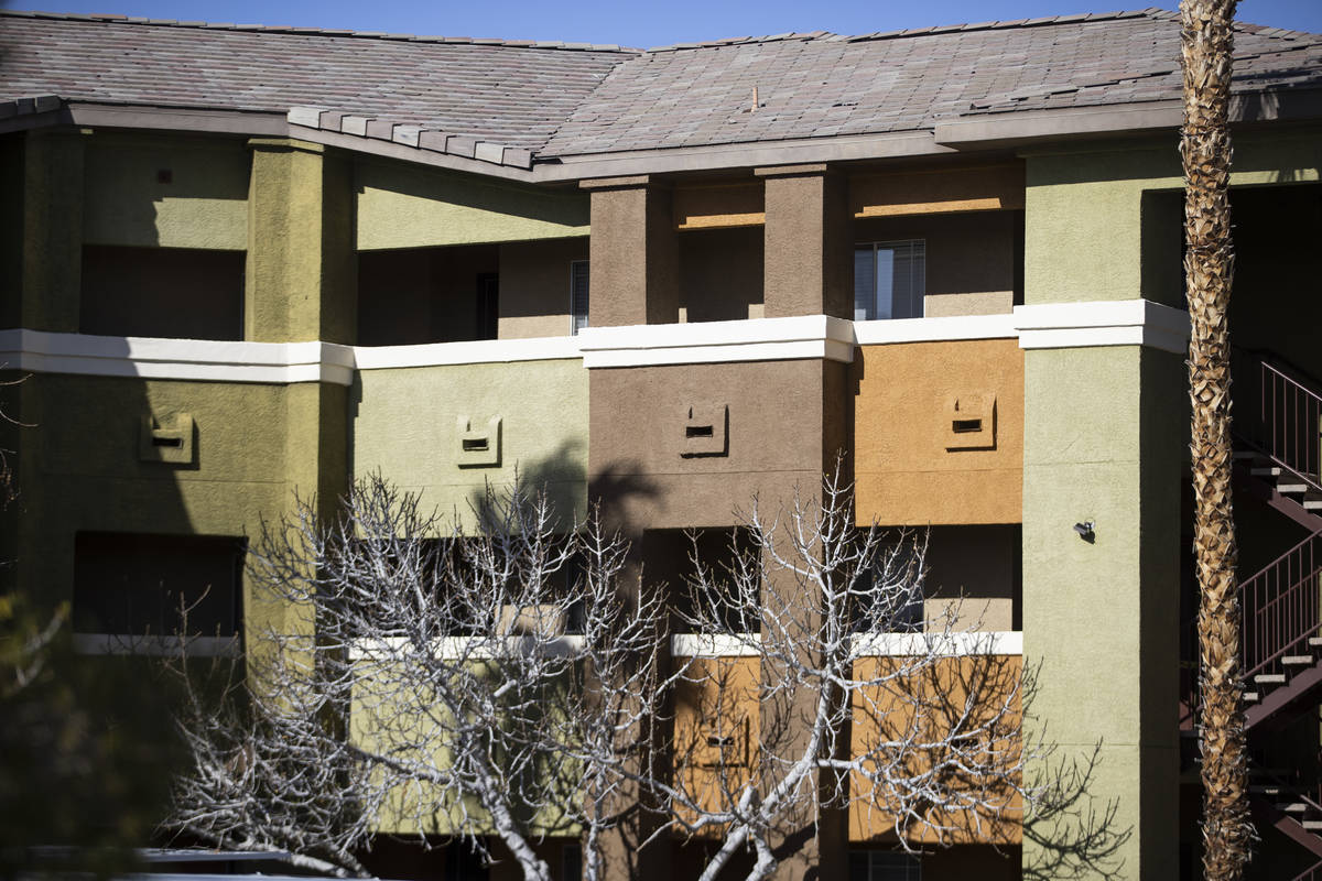 Las Vegas police investigate an apparent murder-suicide inside an apartment at the Falling Wate ...