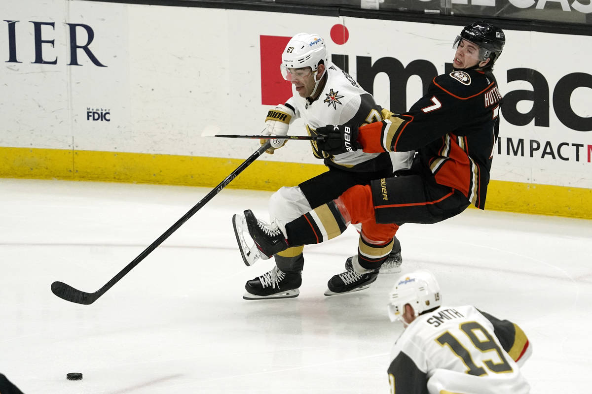 Vegas Golden Knights left wing Max Pacioretty, left, and Anaheim Ducks defenseman Ben Hutton ba ...