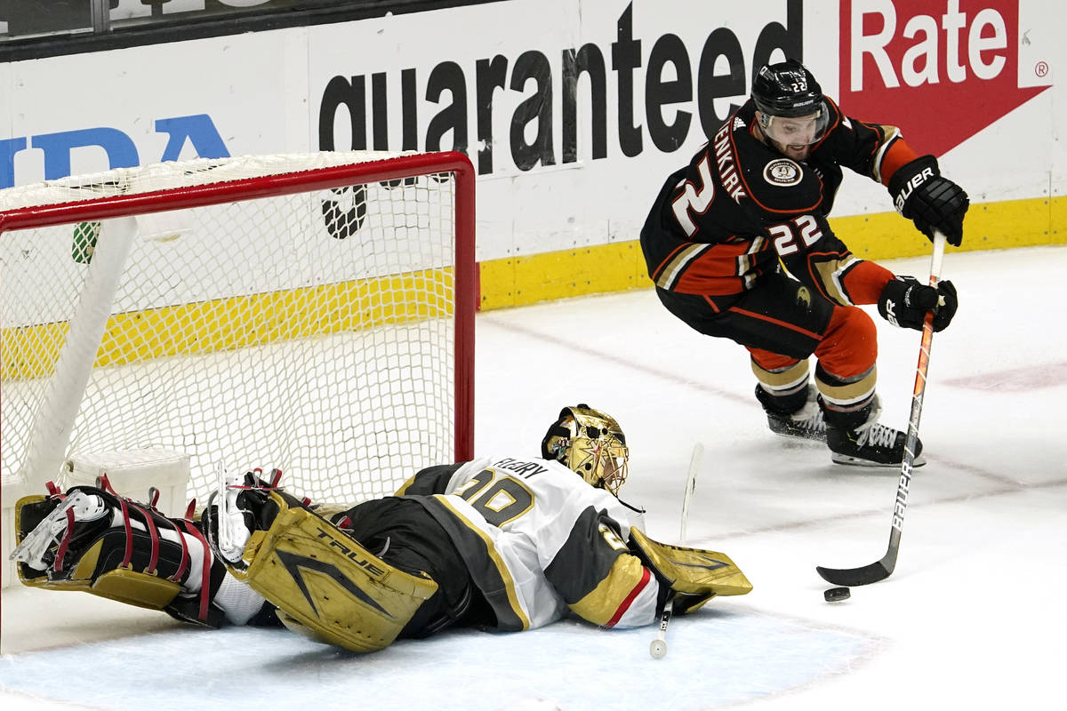 Anaheim Ducks defenseman Kevin Shattenkirk, right, tries to get a shot past Vegas Golden Knight ...