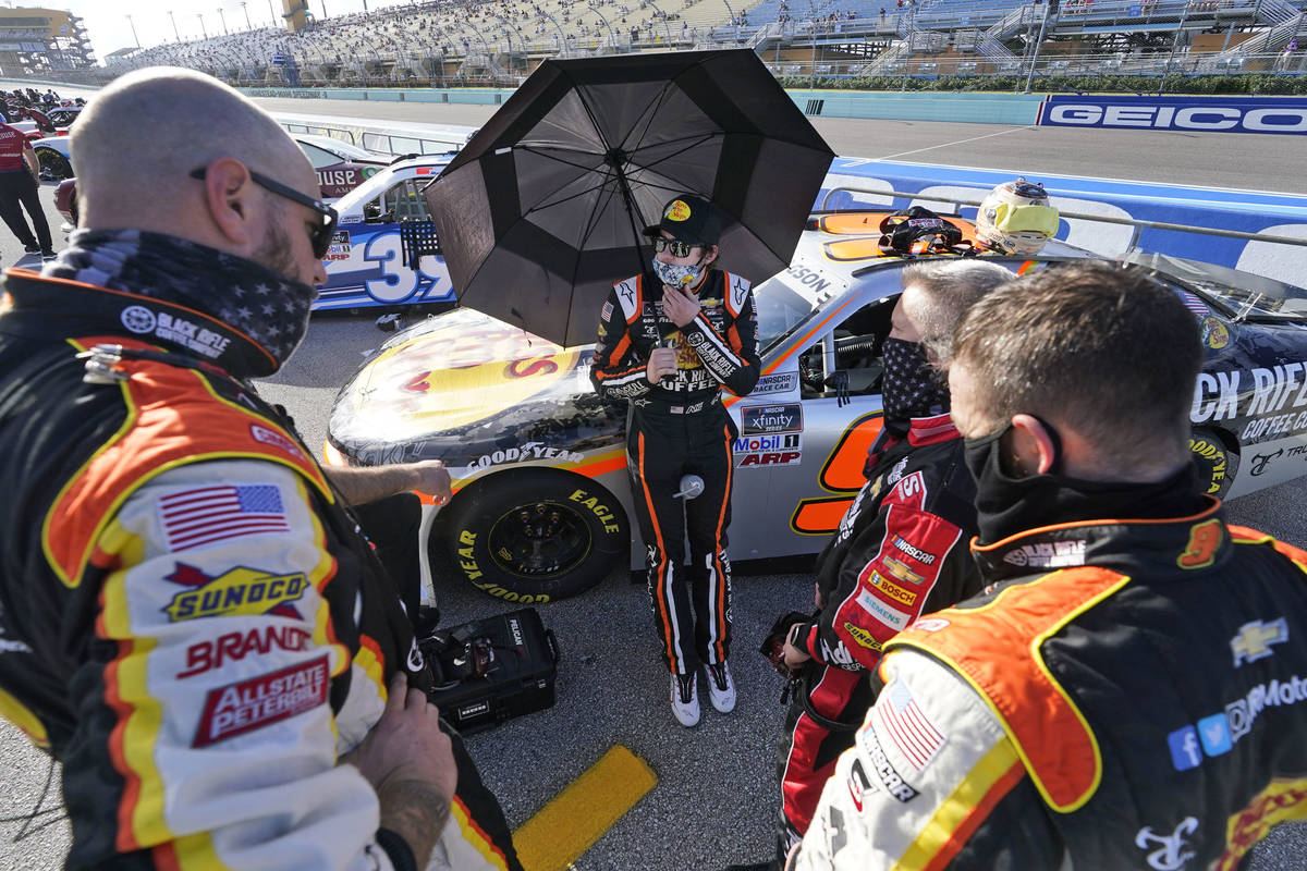 Noah Gragson, center, talks with his crew before the start of a NASCAR Xfinity Series auto race ...