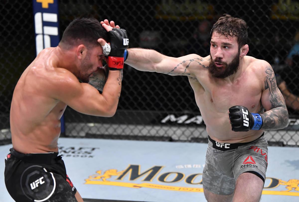 LAS VEGAS, NEVADA - FEBRUARY 27: (R-L) Jimmie Rivera punches Pedro Munhoz of Brazil in a bantam ...
