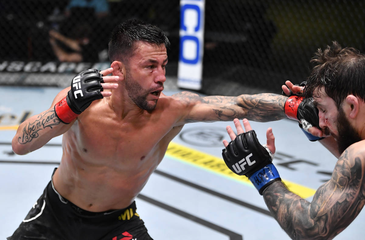 LAS VEGAS, NEVADA - FEBRUARY 27: (L-R) Pedro Munhoz of Brazil punches Jimmie Rivera in a bantam ...