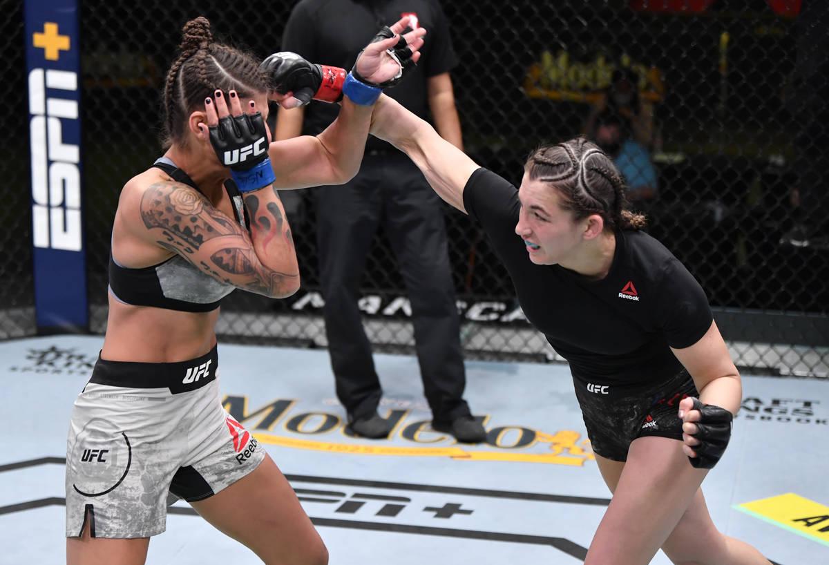LAS VEGAS, NEVADA - FEBRUARY 27: (R-L) Montana De La Rosa punches Mayra Bueno Silva of Brazil i ...
