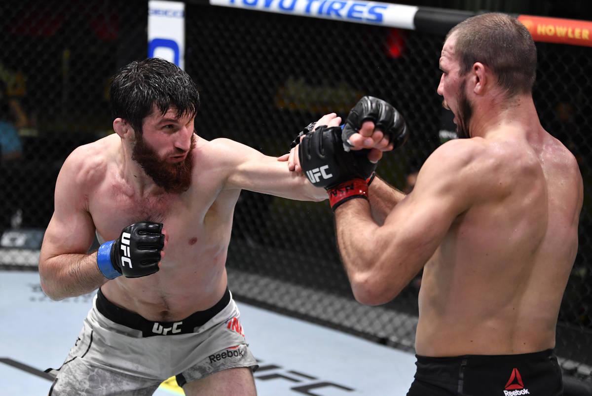 LAS VEGAS, NEVADA - FEBRUARY 27: (L-R) Magomed Ankalaev of Russia punches Nikita Krylov of the ...