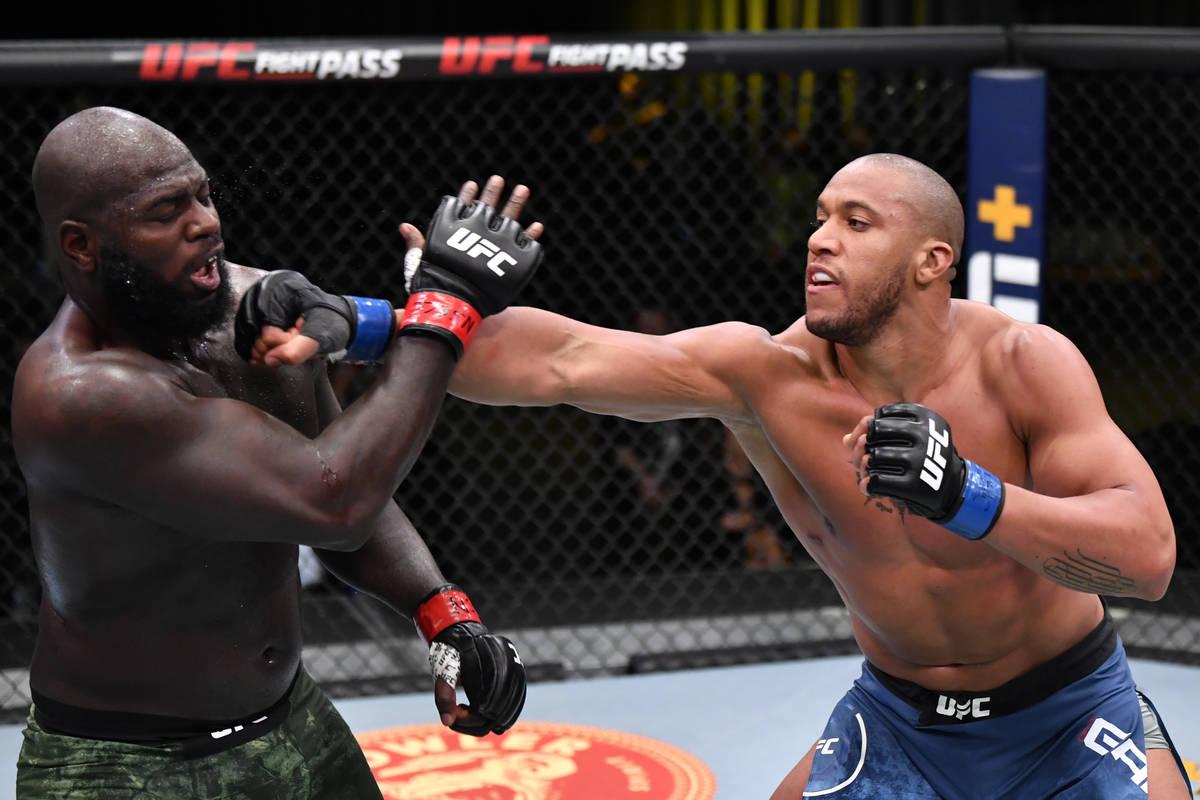 LAS VEGAS, NEVADA - FEBRUARY 27: (R-L) Ciryl Gane of France punches Jairzinho Rozenstruik of Su ...