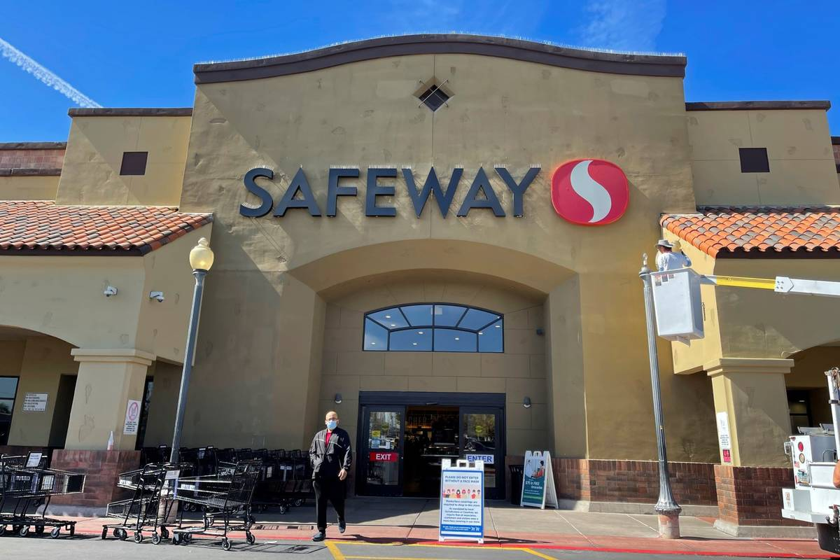 An unidentified shopper leaves a Safeway supermarket in central Phoenix on February 23, 2021. ( ...