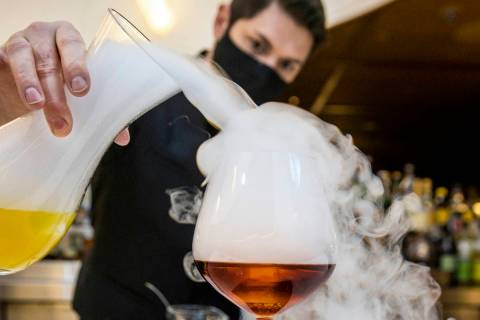 Bartender Casey Freeman creates a Foggy Hill Negroni made with Vida mezcal, Cynar, Aperol, fog ...
