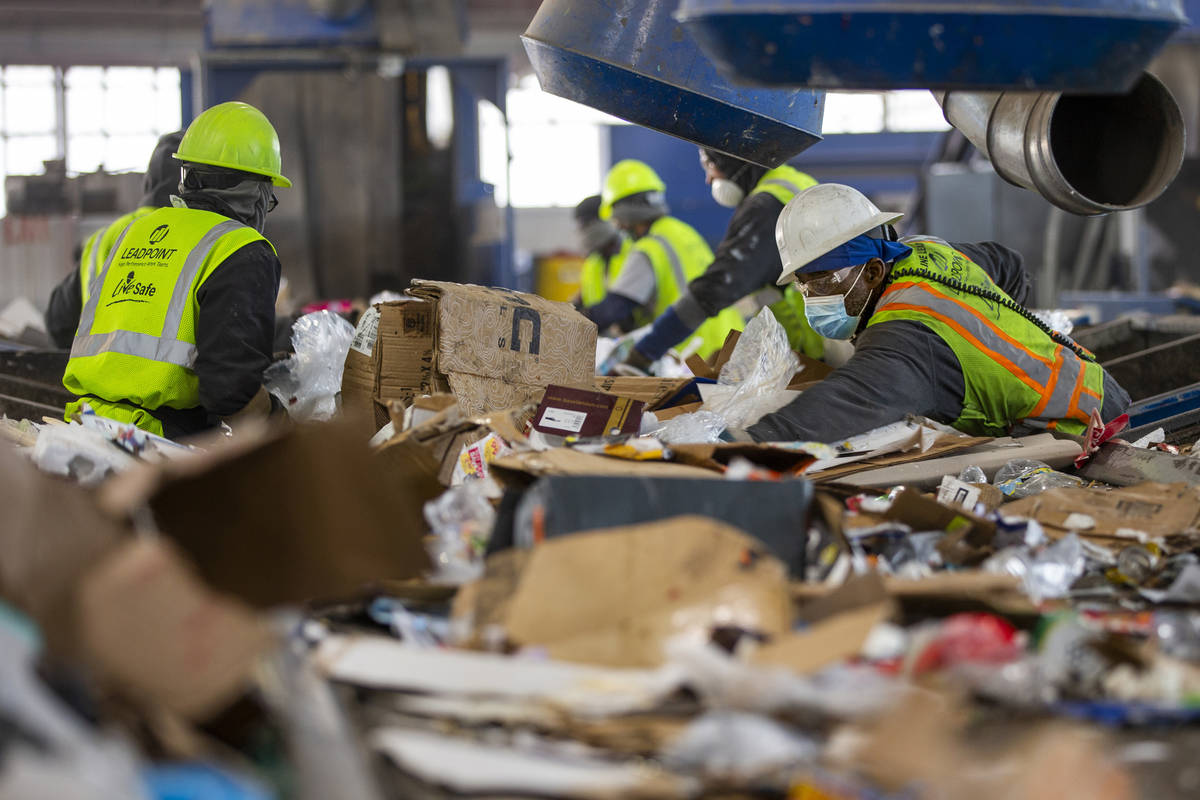 Workers on the pre-sort deck pull out nonrecyclable material and larger items at the Republic S ...