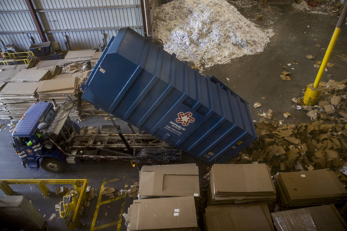 Separated cardboard is dumped to be baled at the Republic Services recycling center on Jan. 15, ...