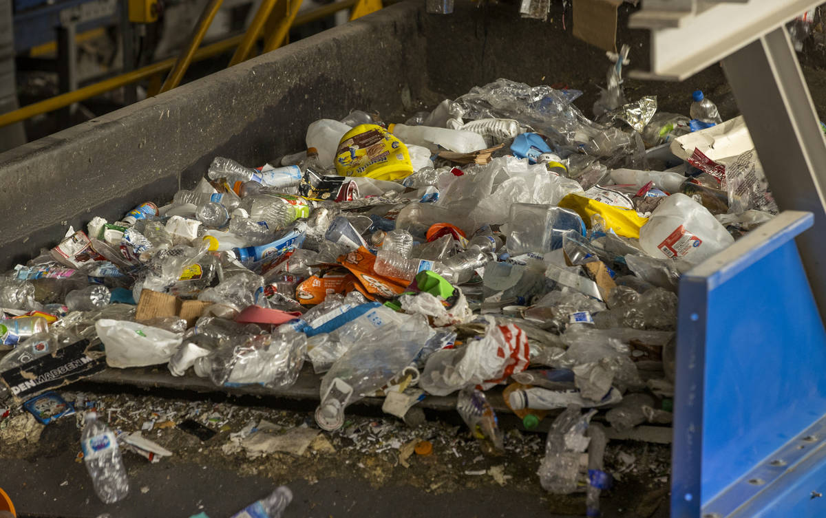 Recyclable material moves along a conveyor belt to be sorted at the Republic Services recycling ...