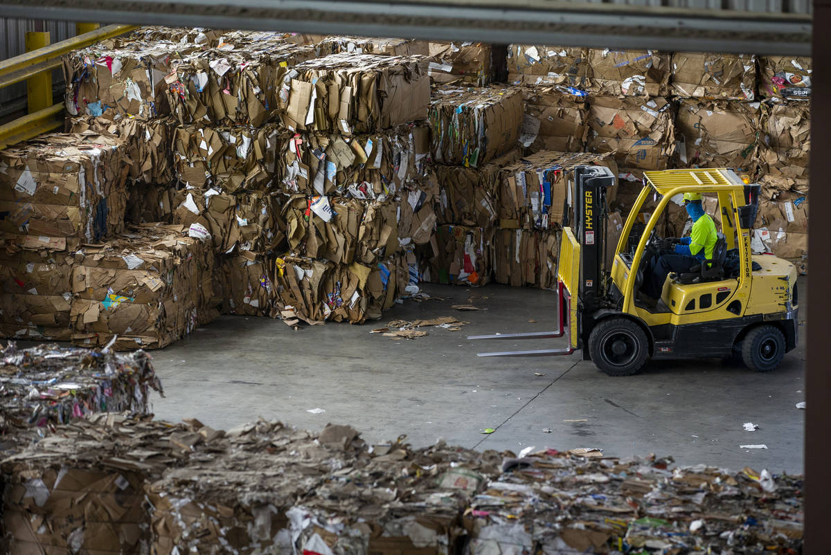 Baled cardboard is stacked for shipping at the Republic Services recycling center on Jan. 15, 2 ...