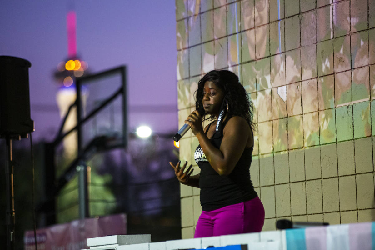 Nicole Williams, of Vegas Urban Pride, speaks during a candlelight vigil, in remembrance of bla ...