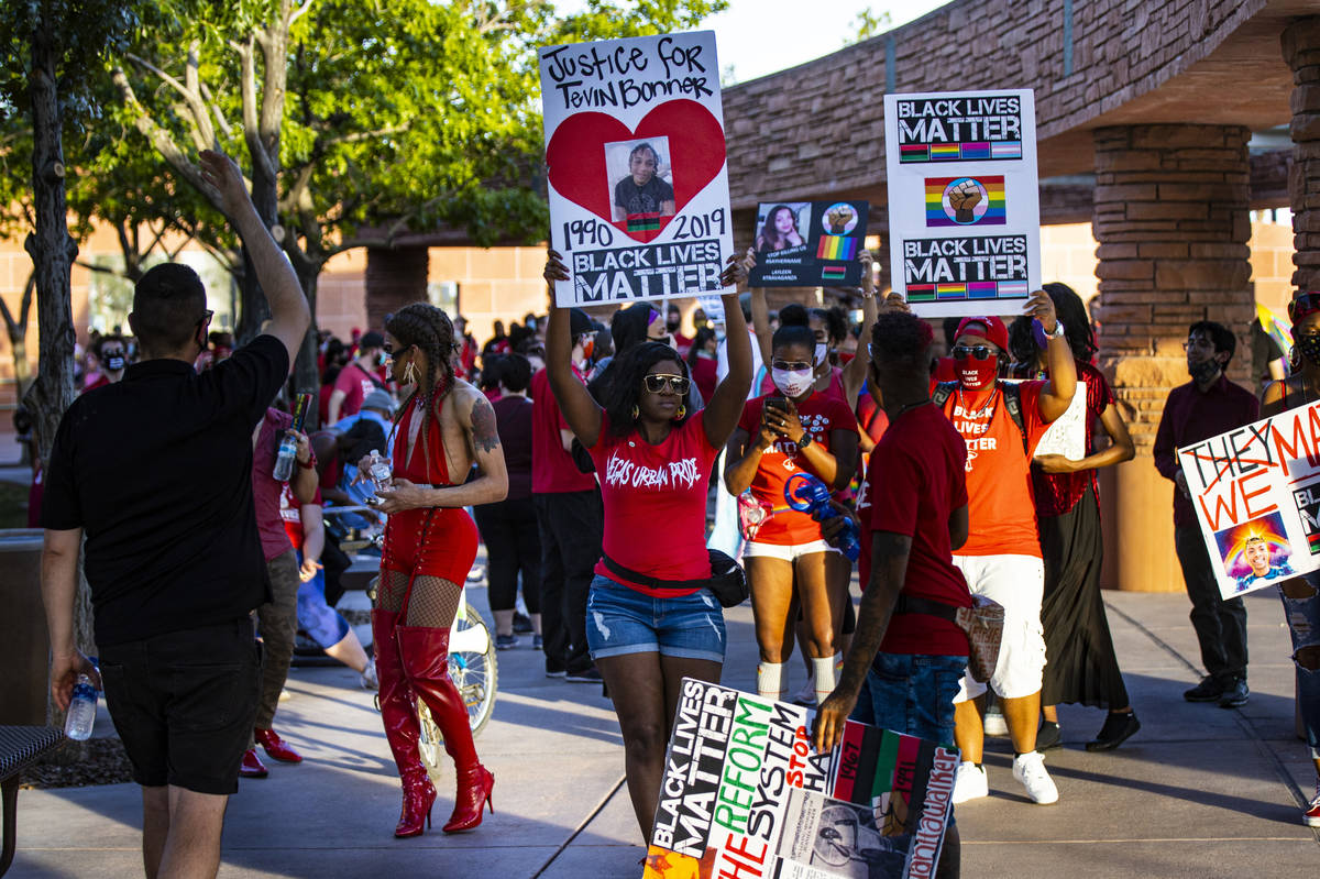 Event organizer Nicole Williams, center, helps lead a silent solidarity march in support of Bla ...