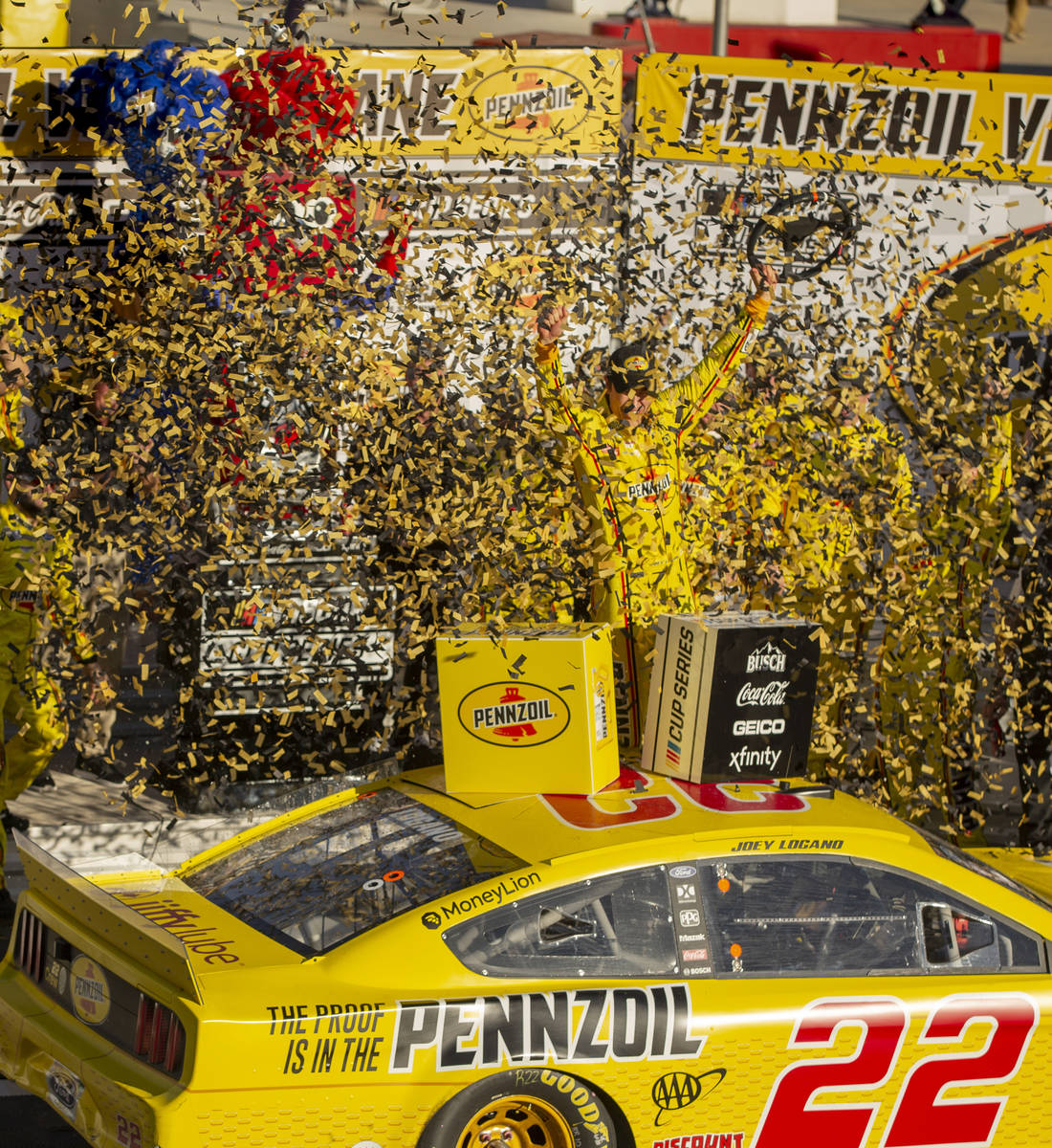 Joey Logano (22) is blasted with confetti as he celebrates in the winner's circle following the ...