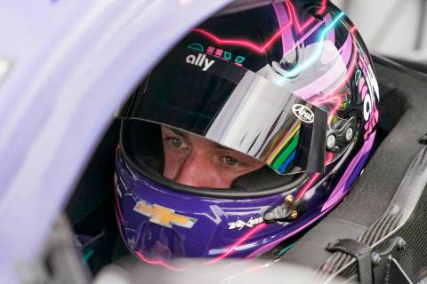 Pole sitter Alex Bowman waits in his car before the start of the NASCAR Daytona 500 auto race a ...
