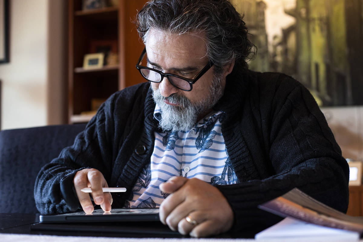 """Alex Raffi draws on his iPad at his home in Henderson. He wrote and illustrated """"The Sound of L ..."""