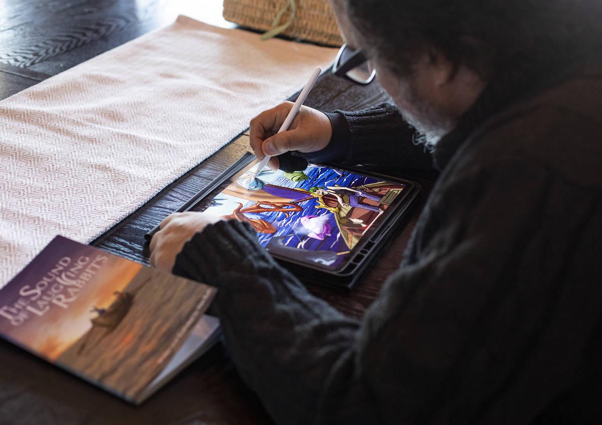 Author and illustrator Alex Raffi draws on his iPad at his home in Henderson. (Rachel Aston/Las ...
