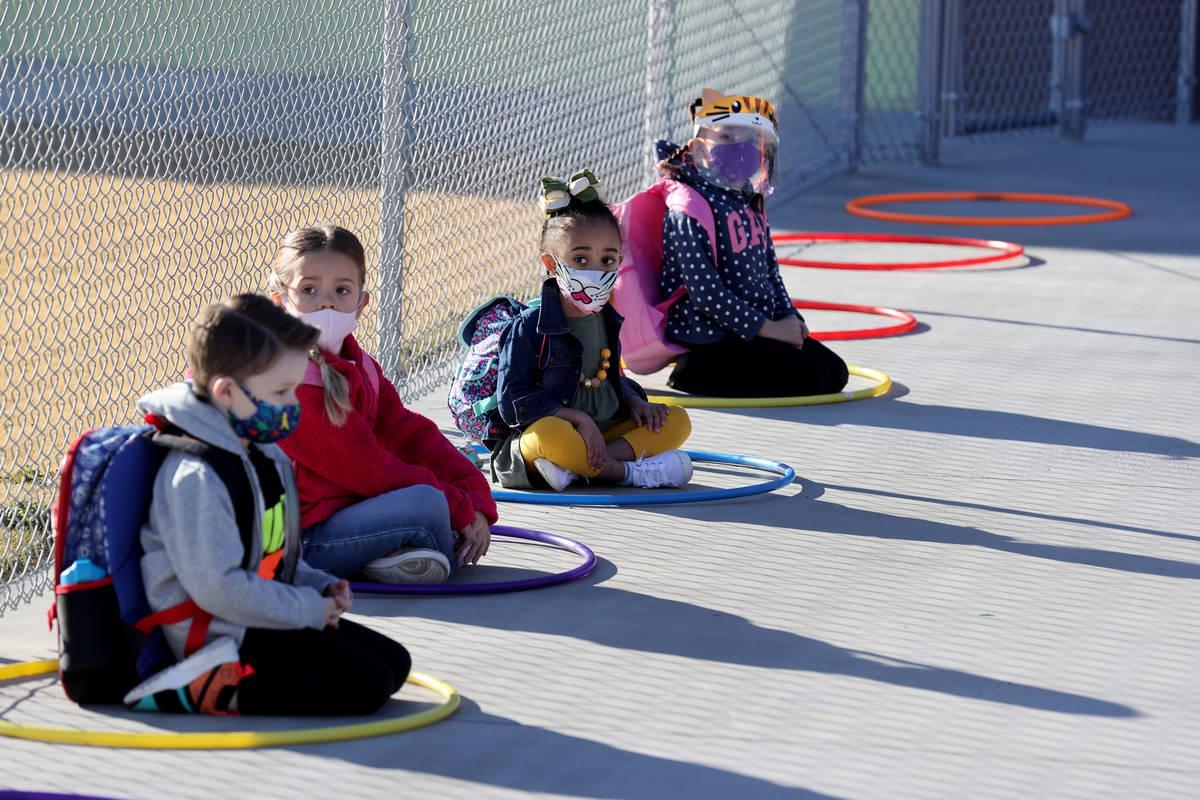 Pre-kindergarten students, from left, Maddux Barton, 5, Hannah Knight, 4, a student whose paren ...