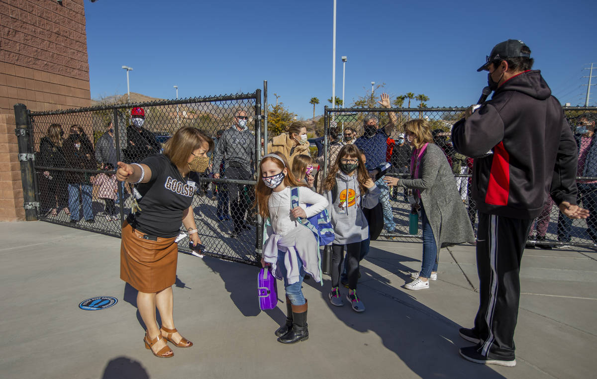 Vice principal Magdalena Casillas, from left, helps direct students through a side gate at Gool ...