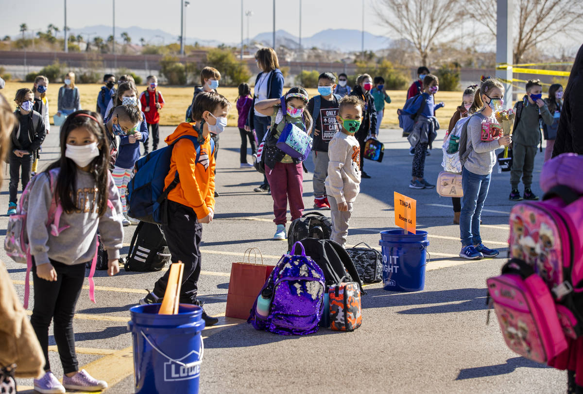 Students stand in lines on the playground assigned by their teachers at Goolsby Elementary Scho ...