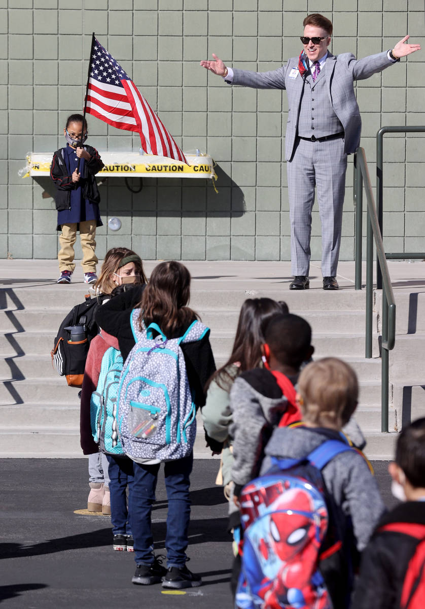 Principal Jaymes Aimetti welcomes student the first day of face-to-face hybrid instruction at B ...